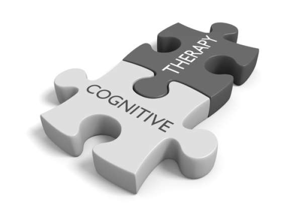 Two puzzle pieces fit together, saying Cognitive Therapyt